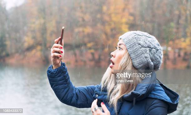 woman searching for a mobile network in woods - no signal - radio wave stock pictures, royalty-free photos & images