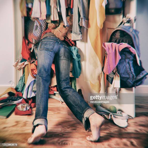 woman searching in messy closet. - arrangement stock pictures, royalty-free photos & images