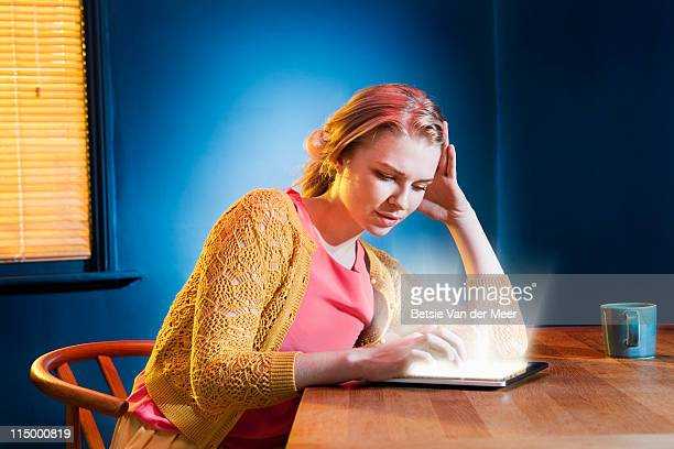 woman searching on digital tablet.