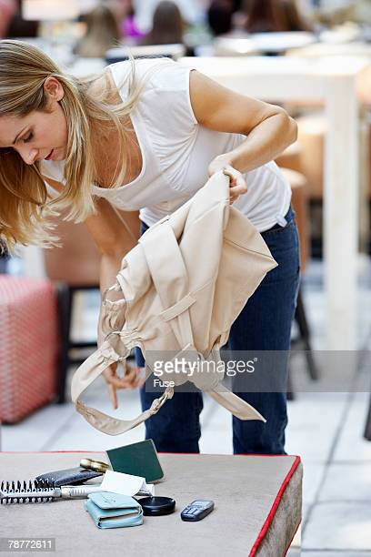 Woman Searching Through Her Purse