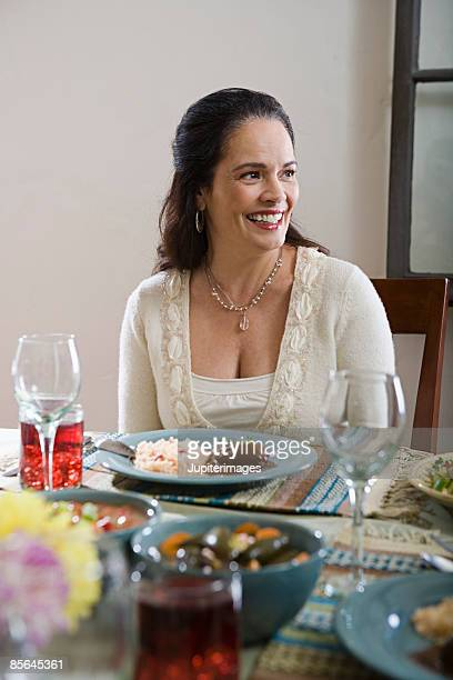 woman seated at dining table - mole sauce stock pictures, royalty-free photos & images