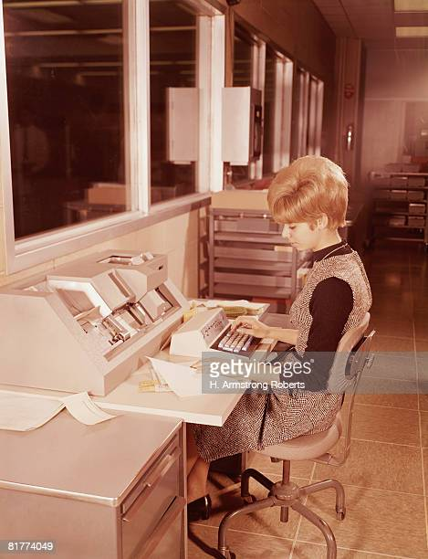 woman seated at keyboard. (photo by h. armstrong roberts/retrofile/getty images) - 1970~1979年 ストックフォトと画像