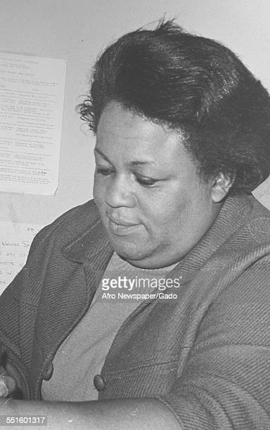 A woman seated at the meeting and the formation of a credit union in the Anti Poverty campaign 1966