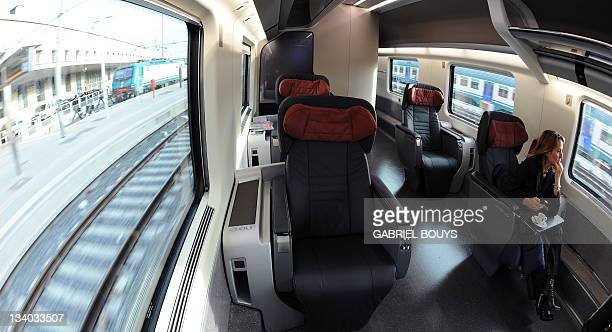 A woman seats in the new executive class of a Freccia Rossa highspeed train near Naples on November 24 2011 The new Freccia Rossa with four different...