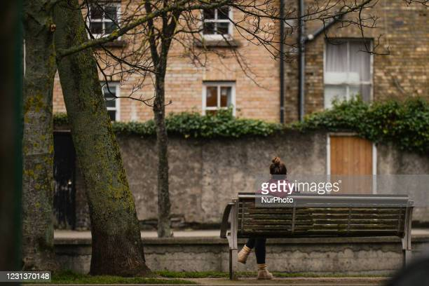 Woman seats on a public bench near the Grand Canal in Portobello area of Dublin during Level 5 Covid-19 lockdown. On Wednesday, February 24 in...