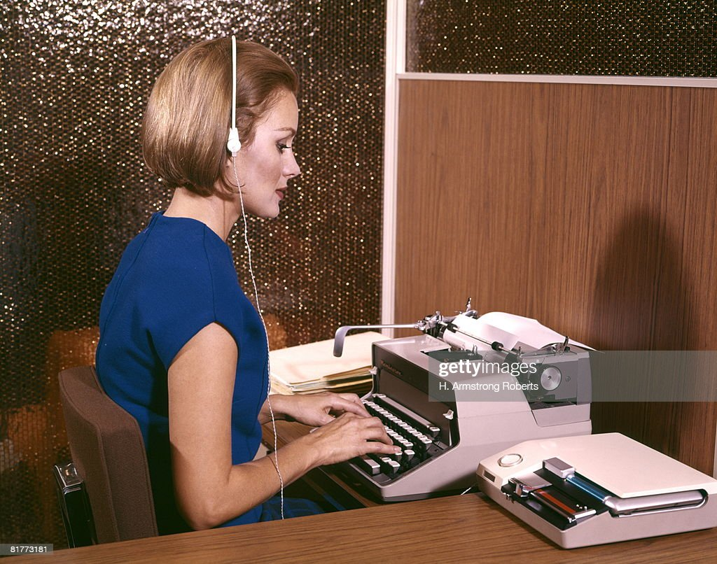 Woman Secretary Typing Typewriter Listening To Dictation On Tape Recorder Earphones  Headset Desk High-Res Stock Photo - Getty Images