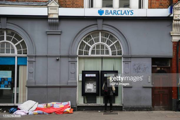 Woman seen at the Barclays Bank cash point machine in north London.