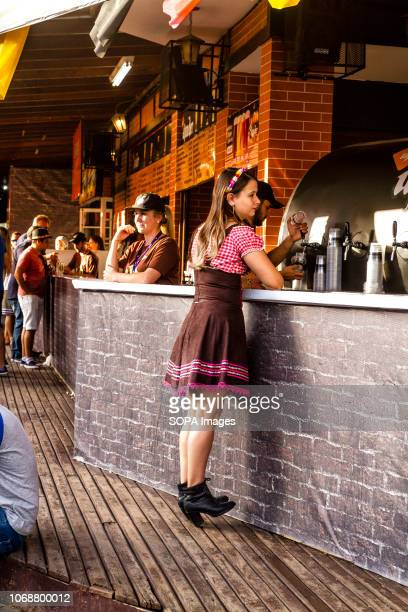 A woman seen at the counter during the festival Oktoberfest 2018 is a Germany beer festival in Blumenau a Brazilian city founded by German immigrants...