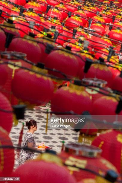 A woman seen at the Thean Hou Temple on the first day of Chinese New Year Chinese New Year is the first day of the New Year in the Chinese calendar...