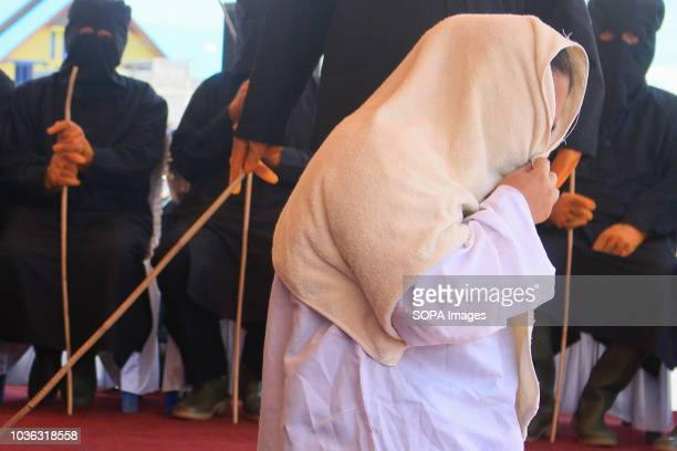 A woman seen being whipped on the public stage 19 people were sentenced by the Meulaboh Sharia Court to being whipped in public for sexually abusing...