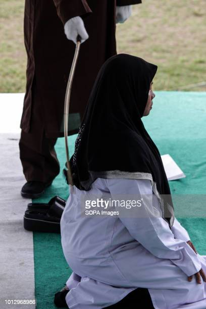 LHOKSEUMAWE ACEH INDONESIA A woman seen being whipped on the public stage Four people were convicted by the Lhokseumawe Sharia Court of various...