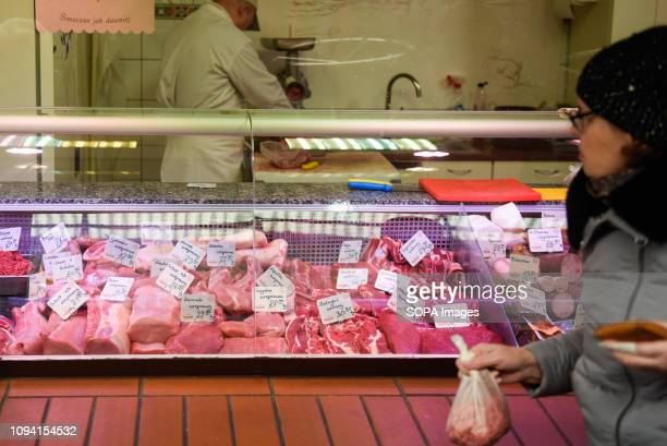 A woman seen buying pieces of meat at a meat market European Union investigators began a weeklong visit to Poland on Monday after a video showing...