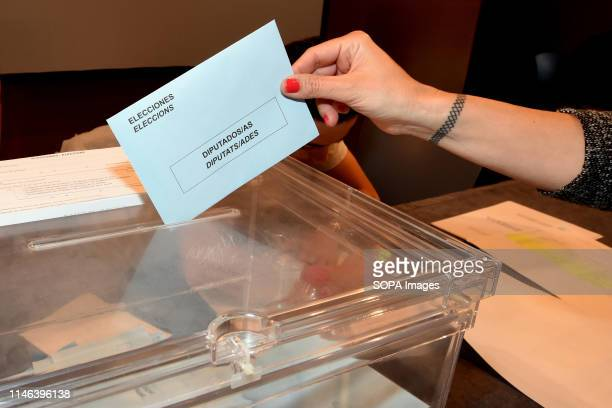 EL VENDRELL TARRAGONA SPAIN A woman seen casting her vote for the European deputies and for the mayoralty of the city of El Vendrell Catalonia Spain...