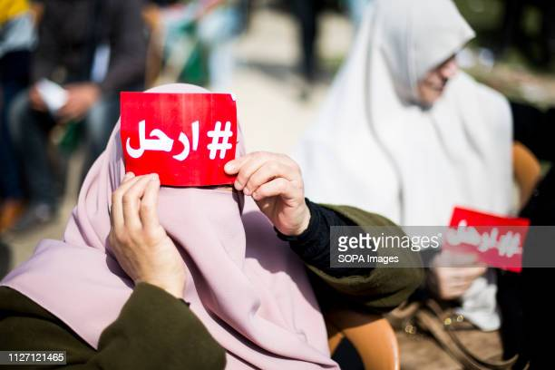 A woman seen covering her eyes with a placard during the demonstration Palestinians take part in a protest demanding Palestinian President Mahmoud...