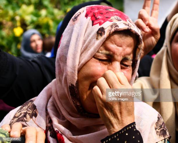 A woman seen crying during the funeral of martyr Naji Jamal alZa'anin Naji Jamal alZa'anin 25 years old was killed by an Israeli airstrike in the...