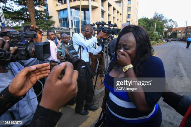 A woman seen crying walking next to media people after getting away from the attack against an Hotel in NairobiThe attack started at around 330 pm...