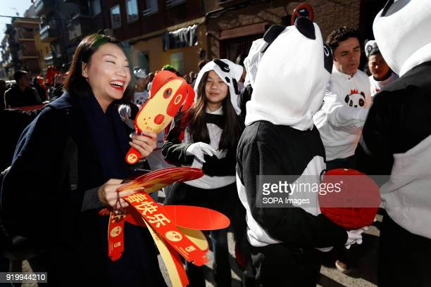A woman seen distributing dog's masks during the chinese new year parade Thousand of participants take part in the Chinese New Year parade in Madrid...