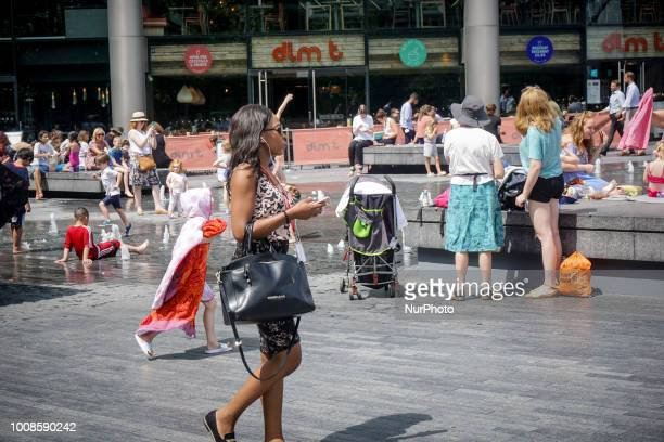 A woman seen during a hot day in London July 26 2018 According to the Met Office July is likely to be the hottest month since record began As the...