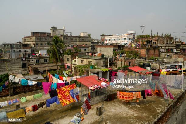 Woman seen hanging clothes to dry at the Hazaribagh tannery factory area. Most people in this area have become victims of pollution due to the...