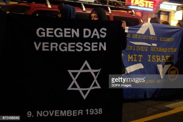 Woman seen holding a banner during the demonstration in support of the victims of antisemitism About 100 demonstrators take part in the demonstration...