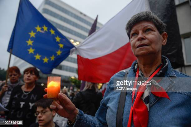A woman seen holding a candle during the protest People demonstrate against reforms of the Supreme Court and demand for free courts in Krakow Poland