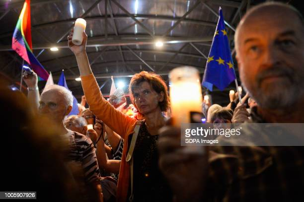 A woman seen holding a candle on the 7th day of a protest demanding free courts in front of Krakow court The ruling Law and Justice party adopted...