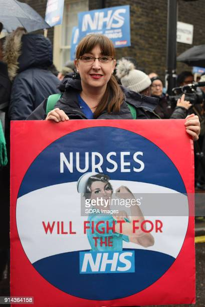 A woman seen holding a placard during the demonstration Thousand of people marched in London in a protest called 'NHS in crisis fix it now' to call...