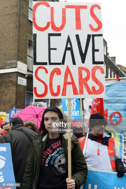 A woman seen holding a placard during the demonstration Thousand of people marched in London in a protest called NHS in crisis fix it now to call for...