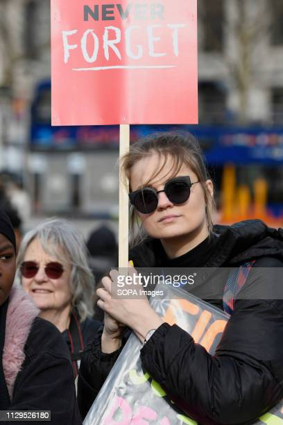 A woman seen holding a placard during the Million Women's Rise march in London Thousands of women marched through central London to a rally in...
