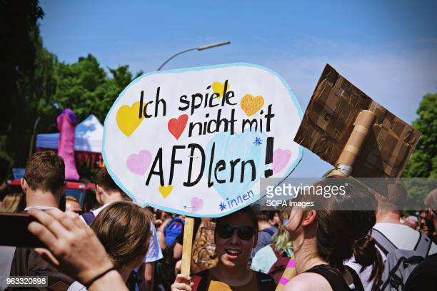 A woman seen holding a placard during the protest Techno lovers and anti racism activists have marched in Berlin against a rally organised by the...