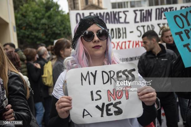 A woman seen holding a placard during the protest Women demonstrate about the eradication of violence against women