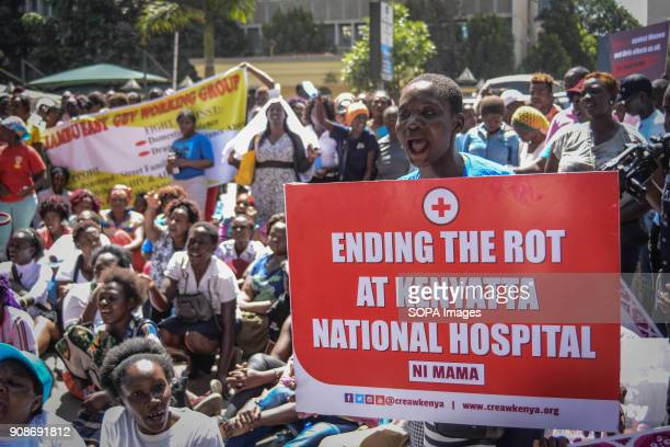 A woman seen holding a placard shouting slogan to protest against the recent reported rape allegations at the Kenyatta National Hospital the largest...