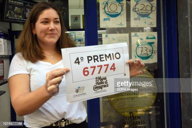 L´HOSPITALET BARCELONA SPAIN A woman seen holding a placard with a lottery number 67774 that was sold during the celebrations Christmas lottery 2018...