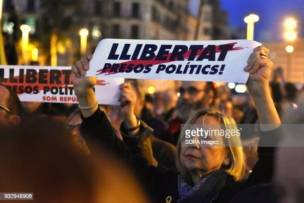 A woman seen holding a placard writting on it 'freedom political prisoners' during a protest Hundreds of people have taken to the streets to demand...