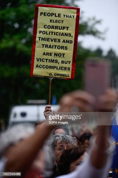 A woman seen holding a poster during the protest People demonstrate against reforms of the Supreme Court and demand for free courts in Krakow Poland