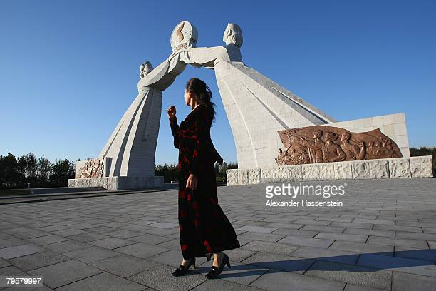 A woman seen in front of the Monument of Three charter for national Reunification on October 19 2007 in Pyongyang North Korea