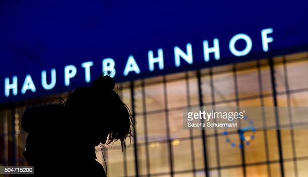 A woman seen in silhouette stands near Hauptbahnhof main railway station where on New Year's Eve gangs of what victims described as North African men...