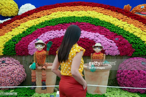 """Woman seen looking at """"Bill and Ben the Flower Pot Men"""" garden design during the Chelsea Flower Show. The Royal Horticultural Society Chelsea Flower..."""