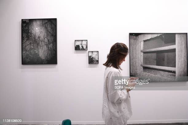 A woman seen next to art pieces during the exhibition The 38th edition of the contemporary art fair is held from February 27 to March 3 in the...