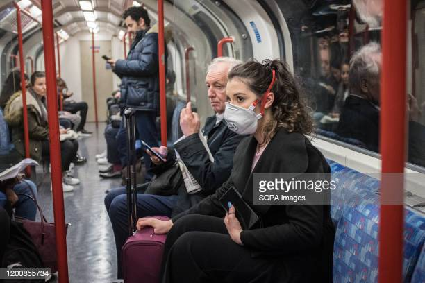 A woman seen on a tube wearing a face mask A total of nine people in the UK are now being treated for COVID19 the disease caused by the coronavirus...