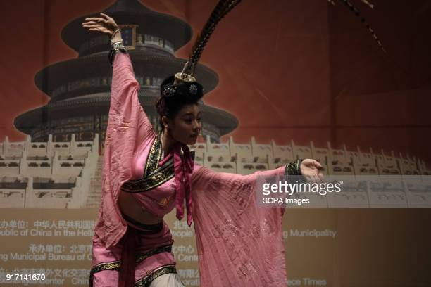 A woman seen performing the traditional chinese dance alone during the 'Chinese New Year Night of Beijing' event The Beijing National Orchestra holds...
