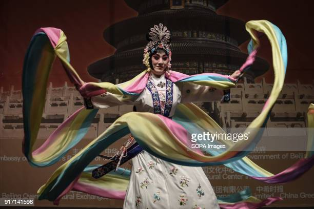 A woman seen performing the traditional chinese dance with a large multicolored scarf during the 'Chinese New Year Night of Beijing' event The...