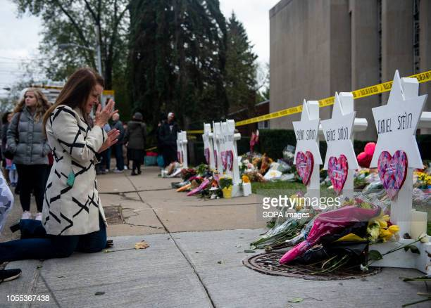 A woman seen praying at the memorial service for the victims of the Tree of Life Massacre Members of Pittsburgh and the Squirrel Hill community pay...