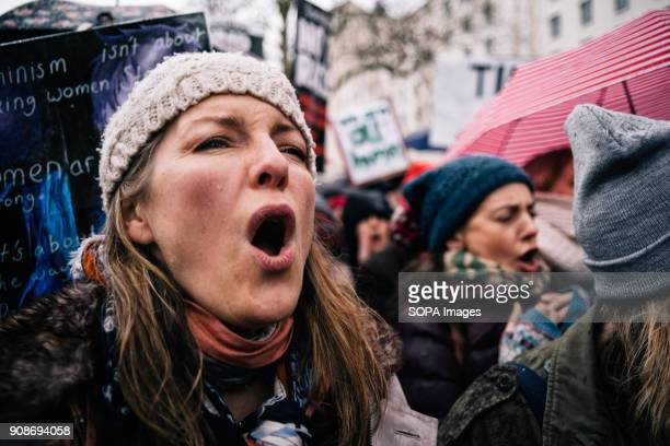A woman seen shouting slogans during the march Scores of women across the United Kingdom took to the streets on Sunday to protest sexual harassment...
