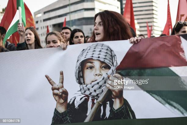 A woman seen shouting slogans while holding a large banner during a protest to demand the release of a 16yearold Palestinian girl named Ahed Tamimi...