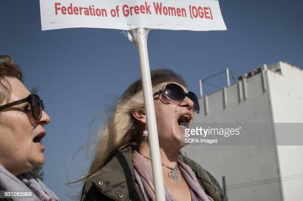 A woman seen shouting slogans while holding a placard during a protest to demand the release of a 16yearold Palestinian girl named Ahed Tamimi held...