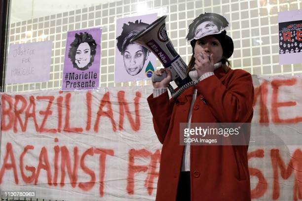 A woman seen speaking addressing the assistants during the Vigil in memory of Brazilian activist Marielle Franco Protesters gathered outside the...
