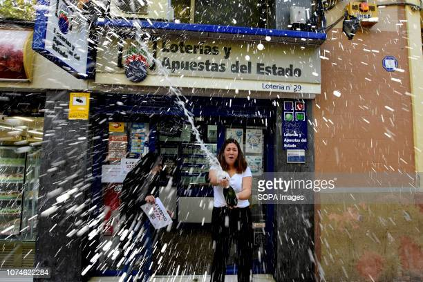 L´HOSPITALET BARCELONA SPAIN A woman seen splashing champagne during the celebrations Christmas lottery 2018 celebrations of a fourth prize draw...