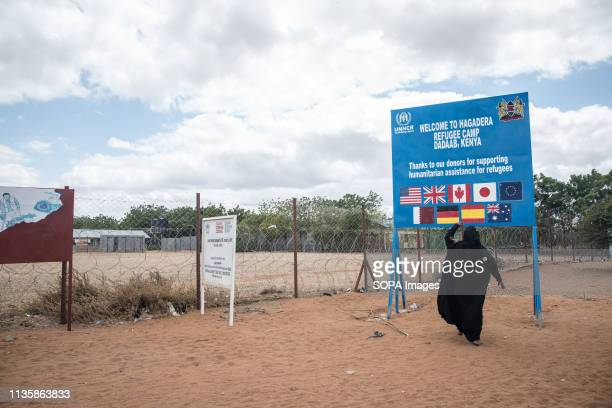 Woman seen standing in front of a UNHCR sign in the refugee camp. Dadaab is one of the largest refugee camps in the world. More than 200,000 refugees...