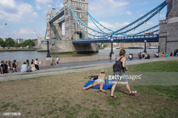 A woman seen sunbathing during a hot day in central London High temperatures in the United Kingdom will continue and the temperatures will be 35...